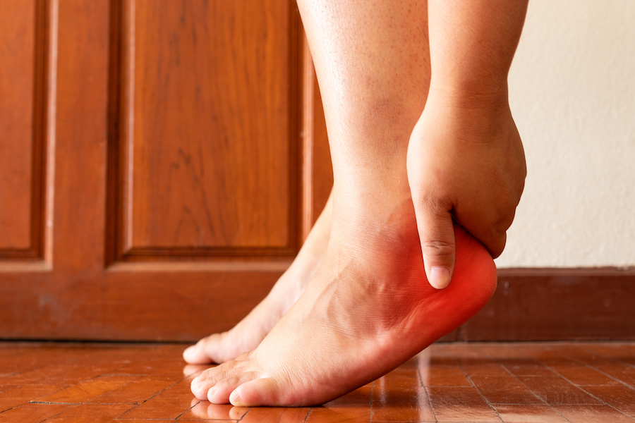 Person with heel pain, plantar fasciitis